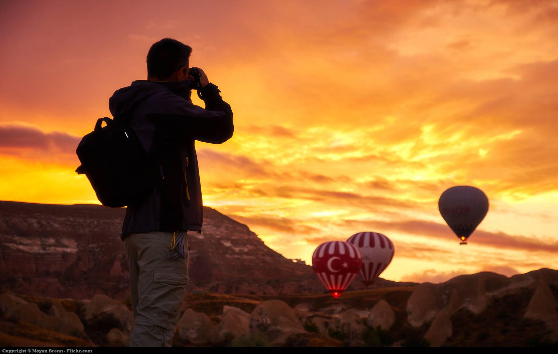 man-travel-binoculars